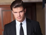 An attractive man in black suit